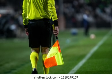 Thessaloniki, Greece - February 19, 2019: The assistant referee holds his flag out for an offside during the match UEFA Youth League for second round between Paok - Tottenham at Toumba stadium