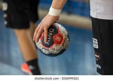 Thessaloniki, Greece - February 24, 2018: Undefined hands holding a ball prior to the Greek handball Championship between the teams Paok vs Philip at PAOK sports arena