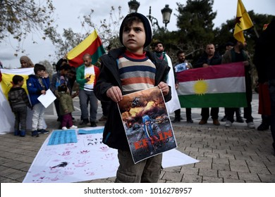 Thessaloniki, Greece - February 3, 2018. A Kurdish boy holds a photo during a protest against Turkish military operations in the Kurdish-majority Afrin canton in northern Syria.