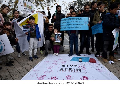 Thessaloniki, Greece - February 3, 2018. Kurdish people hold banners during a protest against Turkish military operations in the Kurdish-majority Afrin canton in northern Syria.