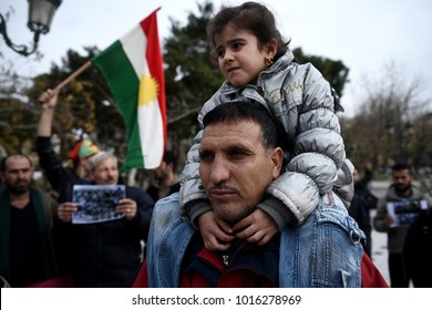 Thessaloniki, Greece - February 3, 2018. A Kurdish man holds his daughter on his shoulders during a protest against Turkish military operations in the Kurdish-majority Afrin canton in northern Syria.