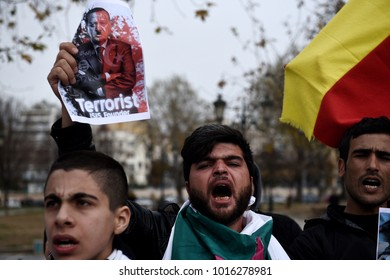 Thessaloniki, Greece - February 3, 2018. A Kurdish man holds a photo of Tayyip Erdogan during a protest against Turkish military operations in the Kurdish-majority Afrin canton in northern Syria.