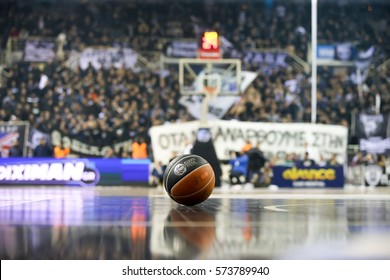Thessaloniki, Greece, February 5, 2017: ball in the foreground and blurred crowd in backraount during the Greek Basket League game Paok vs Aris at PAOK sports arena.
