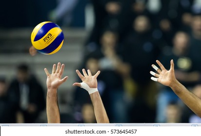 Thessaloniki, Greece - February 6, 2017: Closeup of hands and ball during the Hellenic Volleyball League game Paok vs Olympiacos at PAOK Sports Arena.
