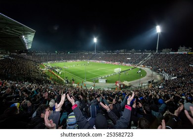 THESSALONIKI, GREECE FEBRUARY 8, 2015 : View of the Toumba Stadium full of fans and supporters of PAOK who light flares during the Greek Superleague match PAOK vs Olympiacos
