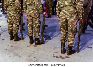 Thessaloniki, Greece Greek Army soldiers in combat uniform, holding a G3A4 rifle. Silhouette of Hellenic Armed forces males standing still, wearing Combat Uniform in a Camouflage Pattern.