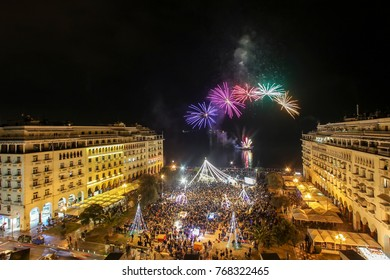 Thessaloniki, Greece -January 1, 2017:  General view in Aristotle's square in Thessaloniki  during New Year celebrations with fantastic multi-colored fireworks, on the night sky