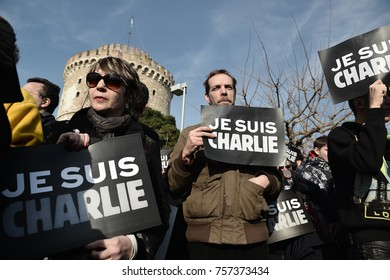 """Thessaloniki, Greece - January 11, 2015. People hold banners which say """"Je Suis Charlie"""", during a protest in memory of the Charlie Hebdo shooting victims, by Islamist Extremists in Paris."""