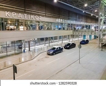 Thessaloniki, Greece - January 12 2019: Parked taxis at the entrance of Thessaloniki SKG airport. Night view of blue and white taxis at arrival area of Thessaloniki International airport Makedonia.