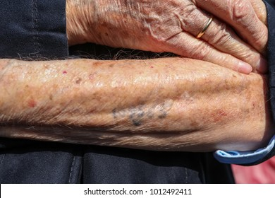 Thessaloniki , Greece January 28, 2018: Holocaust survivor Heinz Kounio shows his tattooed serial number on his arm during a ceremony the persecution of the Jewish people during World War II.