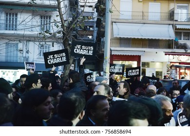 """Thessaloniki, Greece - January 8, 2015. People hold banners writing """"Je Suis Charlie"""", during a vigil in memory of the Charlie Hebdo shooting victims, by Islamist Extremists in Paris."""