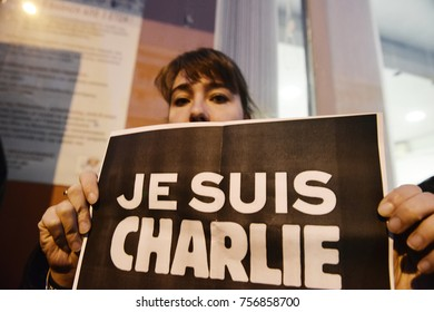 """Thessaloniki, Greece - January 8, 2015. A woman holds a banner which writes """"Je Suis Charlie"""", during a vigil in memory of the Charlie Hebdo shooting victims, by Islamist Extremists in Paris."""