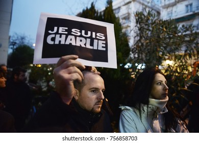 """Thessaloniki, Greece - January 8, 2015. An man holds a banner which writes """"Je Suis Charlie"""", during a vigil in memory of the Charlie Hebdo shooting victims, by Islamist Extremists in Paris."""