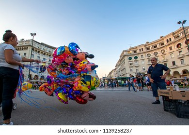 Thessaloniki, Greece - July 06, 2018: Wide angle bright scene with colorful balloons in shape of the famous cartoon characters against the buildings on background on Aristotelous Square