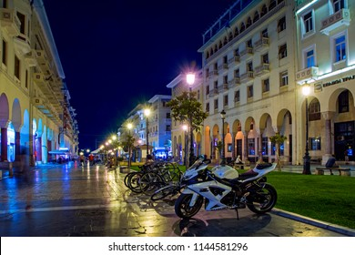 Thessaloniki, Greece - July 06, 2018: Night cityscape with parked motorcycles and bikes at Aristotelous Alley