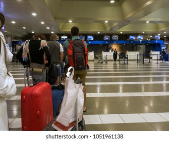 Thessaloniki, Greece - July 17 2017: Thessaloniki SKG airport check-in gates.Passengers waiting in line at service counters prior to departure in Thessaloniki International Airport Macedonia.