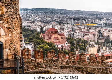 Thessaloniki, Greece- July 24, 2018: Aerial view of Thessaloniki from the ancient walls of the castle and Trigonion Tower in the old city Ano Poli.Focus on St. Paul (Agios Pavlos) church.