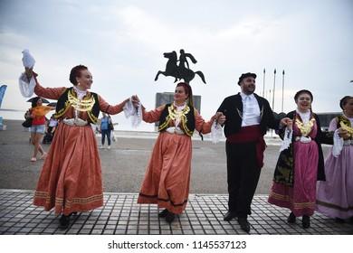 Thessaloniki, Greece - July 30, 2018. People dance a traditional dance in front of the Alexander the Great statue, during a protest regarding Macedonia Naming Dispute, between Greece and Macedonia.