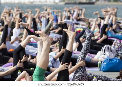 THESSALONIKI, GREECE - JUNE 21, 2015: Thessaloniki open yoga day. People gathered to perform yoga training during the day, outdoor activities