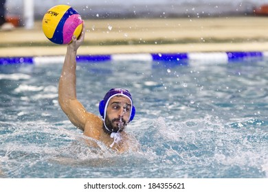 THESSALONIKI, GREECE MAR 22, 2014 : A player of PAOK in action during the Greek League water polo game PAOK vs Vouliagmeni on March 22, 2014.