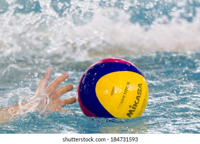 THESSALONIKI, GREECE MAR 22, 2014 : Close-up on a hand holding the water polo ball during the Greek League water polo game PAOK vs Vouliagmeni on March 22, 2014.