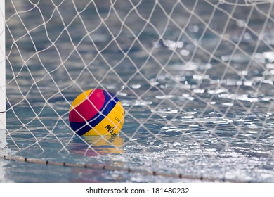 THESSALONIKI, GREECE MAR 5, 2014 : A water polo ball floating on the water in the net during the water polo game PAOK vs Nereas on March 5, 2014.