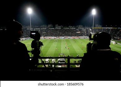 THESSALONIKI, GREECE MAR 9, 2014 : View of the full stadium behind the TV media broadcasting during the Greek Superleague match PAOK vs Olympiacos on March 9, 2014