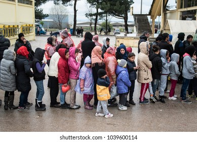 Thessaloniki, Greece - March 10, 2016. Syrian refugees wait in a queue in order to receive food and clothes, inside a refugee camp of near the northern Greek city of Thessaloniki.