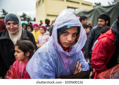 Thessaloniki, Greece - March 10, 2016. Portrait of a refugee girl wearing a raincoat inside a refugee camp of near the northern Greek city of Thessaloniki.