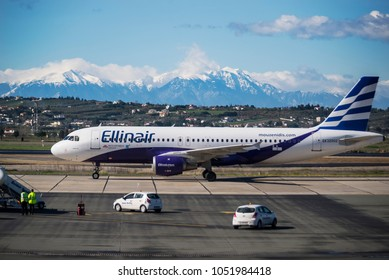 Thessaloniki, Greece - March 20, 2018. An Ellinair Airbus A320 (EK32002) taxes at the apron of Thessaloniki International Airport, with the mount Olympus seen at the background.