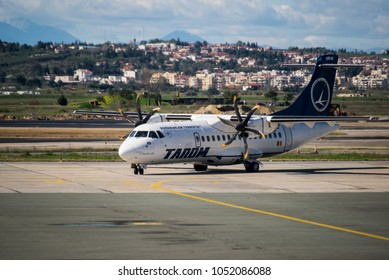 Thessaloniki, Greece - March 20, 2018. A TAROM ATR-42 (YR-ATG) taxes at the apron of Thessaloniki International Airport.