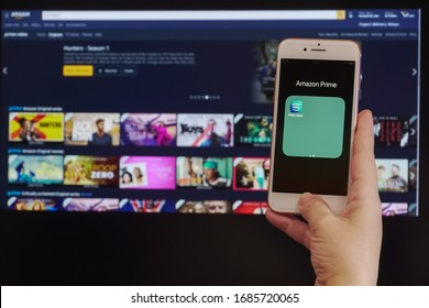 Thessaloniki, Greece - March 21 2020: Amazon streaming Service VoD content provider concept. Hand holds before screen a mobile phone with Amazon Prime Video online watch application login page.