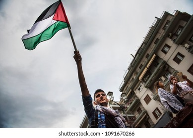 Thessaloniki, Greece - May 15, 2018. A Palestinian living in Greece waves Palestinian flag during an Anti-Israeli protest.