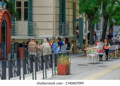 Thessaloniki, Greece - May 25 2020: Bars open for the first day for the summer. Crowd sitting on bar restaurants at the city center, after Hellenic government loosens COVID-19 coronavirus measures.