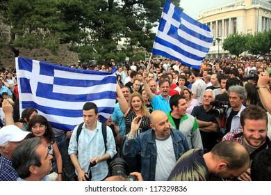 THESSALONIKI, GREECE - MAY 25: Protesters march on the streets in front of Thessaloniki White Tower, against the economic crisis in Greece, on May 25, 2011, Thessaloniki, Greece.