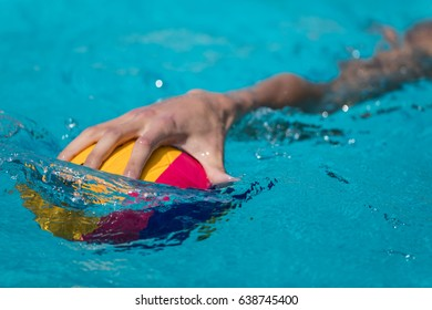 Thessaloniki, Greece May 4, 2017 : Close-up on a hand holding the water polo ball during the Greek League water polo game PAOK vs Glifada