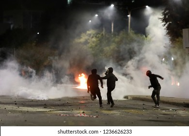 Thessaloniki, Greece - Nov 17,2018:Protestors throw petrol bombs to anti-riot policemen during clashes following a rally commemorating the 1973 students uprising against the US-backed military junta.