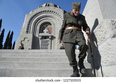 Thessaloniki, Greece - November 11, 2018. An elderly man dressed in soldier's uniform walks inside the Zeitenlik allied cemetery during commemorations to mark 100 years from the end of World War I.