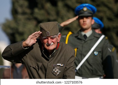 Thessaloniki, Greece - November 11, 2018. An elderly man dressed in soldier's uniform salutes inside the Zeitenlik allied cemetery during commemorations to mark 100 years from the end of World War I.