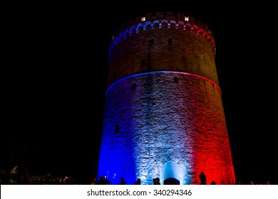 THESSALONIKI, GREECE - NOVEMBER 14: The white tower of Thessaloniki Greece illuminated with the colors of the French flag in memory of the Jihadists ISIS Terrorist Raid in Paris, 2015 in Thessaloniki.