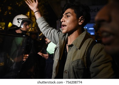 Thessaloniki, Greece - November 15, 2017. A young refugee man reacts in front of a Greek police blockade, as refugees try to march from Thessaloniki to the Greek - Macedonian border.