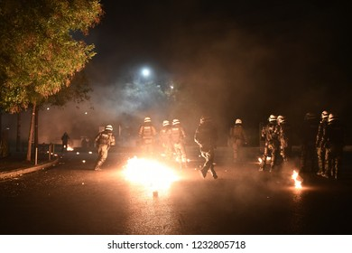 Thessaloniki, Greece - November 17, 2018. Greek police officers try to avoid petrol bombs thrown by protesters during a protest to commemorate 1973 students uprising against military dictatorship.