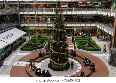 Thessaloniki, Greece - November 25 2017: Plateia mall Christmas tree. People at the decorated Christmas tree at Plateia shopping mall in the center of Thessaloniki.