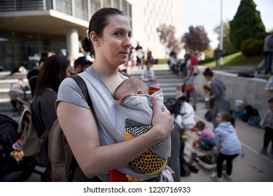 Thessaloniki, Greece - November 4, 2018. A woman carries her baby as she takes part at an annual public breastfeeding event.