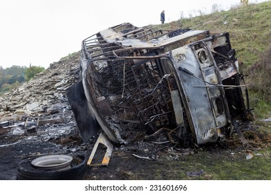 THESSALONIKI, GREECE - NOVEMBER, 5, 2014: Accident with a tour bus that left the road and fell into a cliff and burned to the ground, the driver was killed