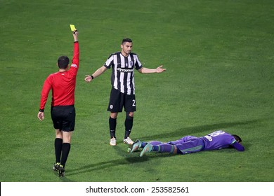 THESSALONIKI, GREECE NOVEMBER 9, 2014 : The referee shows the yellow card to a player during the Greek Superleague match PAOK vs Panathinaikos