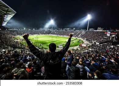 THESSALONIKI, GREECE NOVEMBER 9, 2014 : View of the Toumba Stadium full of fans and supporters of PAOK who light flares  during the Greek Superleague match PAOK vs Panathinaikos