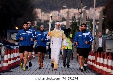 Thessaloniki, Greece - October 27, 2017. A Greek athlete carries the Olympic Flame of Pyeongchang 2018 Winter Olympics, after its arrival in the city.