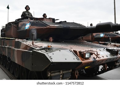 Thessaloniki, Greece - October 28, 2014. The crew of a Greek Army Leopard 2A6 tanks takes part in a parade for the celebration of the entrance of Greece in WWII back in 1940.