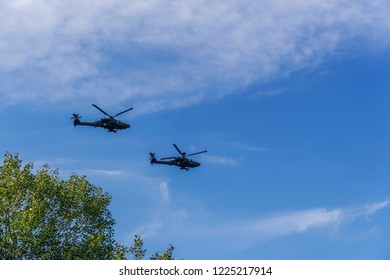 Thessaloniki, Greece - October 28 2018: Greek Air Force Apache helicopters flying. 2 Boeing AH-64 attack helicopters at 28 October military parade, to commemorate Greek no on Italian 1940 ultimatum.